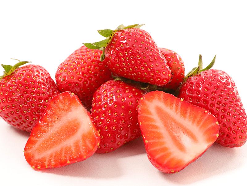 Image de plusieurs fraises disposées les unes sur les autres
